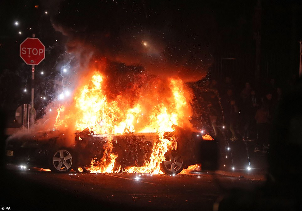 12458218-6938563-A_car_was_torched_by_the_mob_as_violence_erupted_on_the_streets_-a-7_1555643992752.jpg