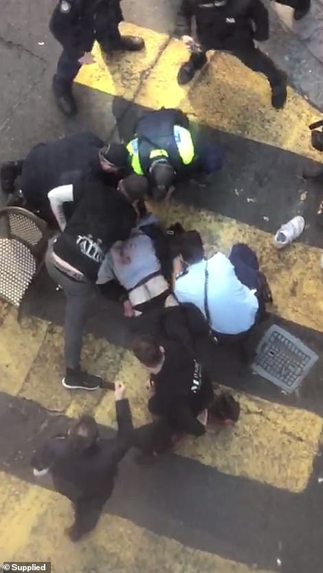 17214812-7351585-The_alleged_attacker_was_pinned_to_the_ground_by_heroic_bystande-a-35_1565688745030