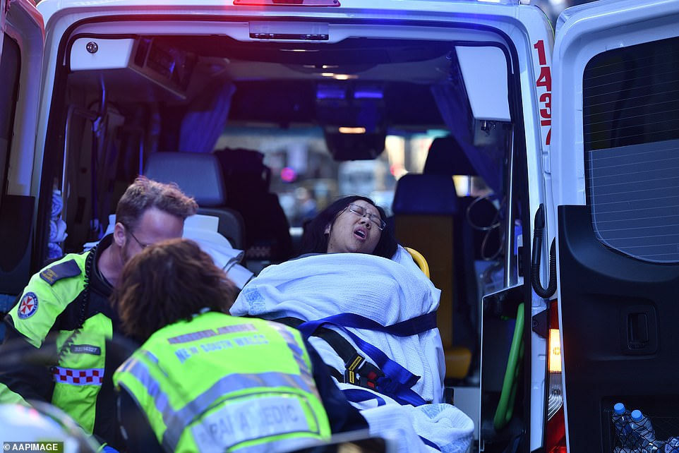 17218812-7351585-A_women_was_pictured_being_taken_by_ambulance_from_a_hotel_after-a-47_1565688745045