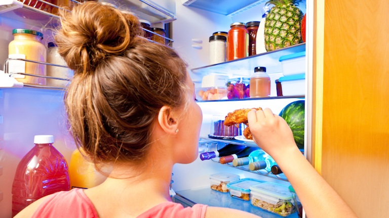 woman-eating-from-fridge-11-reasons-youre-always-hungry-by-healthista.jpg
