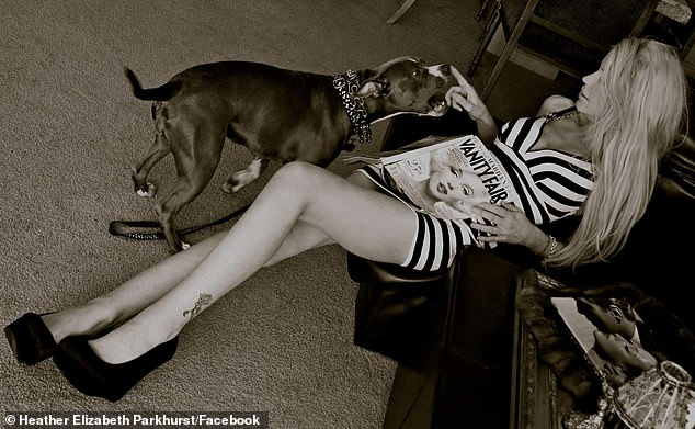 24905436-8016905-A_pinup_and_her_pitbull_The_blonde_also_shared_this_image_with_h-m-105_1582065338875.jpg