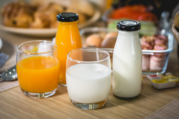 breakfast-with-milk-orange-juice-french-bread-baguette-with-dining-table-morning_41487-278.jpg